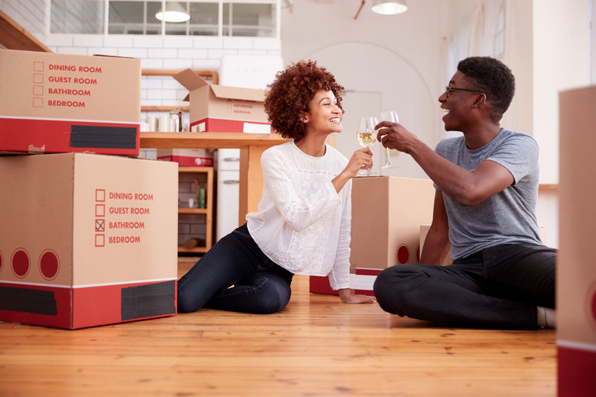 young couple celebrating moving in to their new home